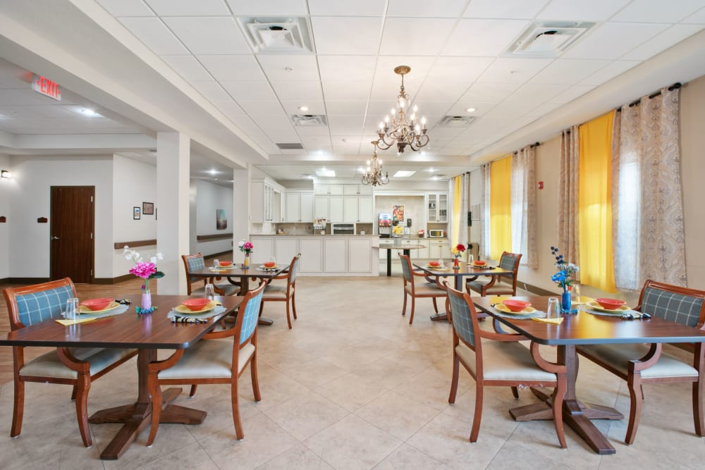 Spacious resident dining area at Merrill Gardens at Solivita Marketplace in Kissimmee, Florida.