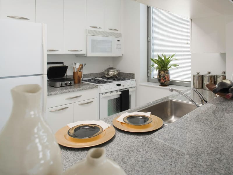A beautiful kitchen with white appliances at The Metropolis in New York, New York