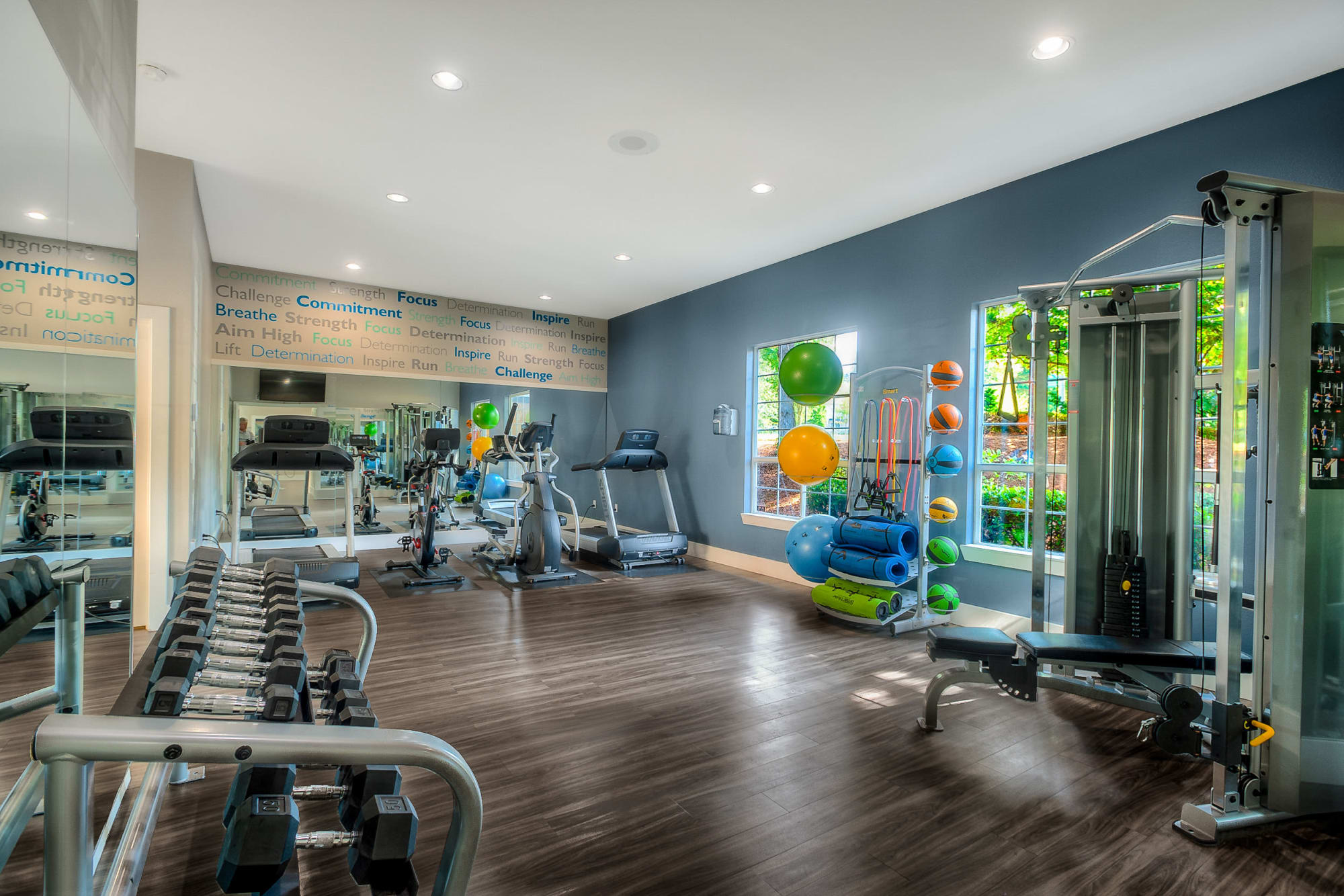 fitness room with cardio and free weights at Newport Crossing Apartments