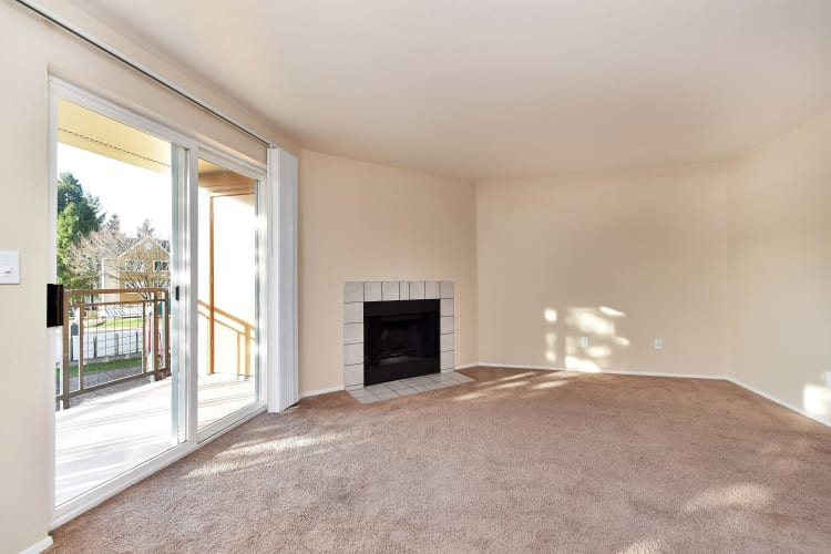 Open living room space with fireplace at Preserve at Sunnyside Apartments