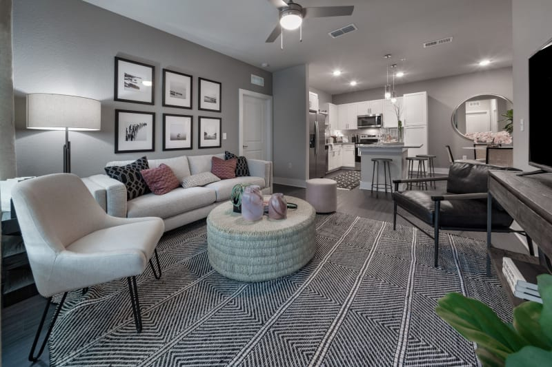 Spacious living room and kitchen area in a model home at Reunion at 400 in Kissimmee, Florida