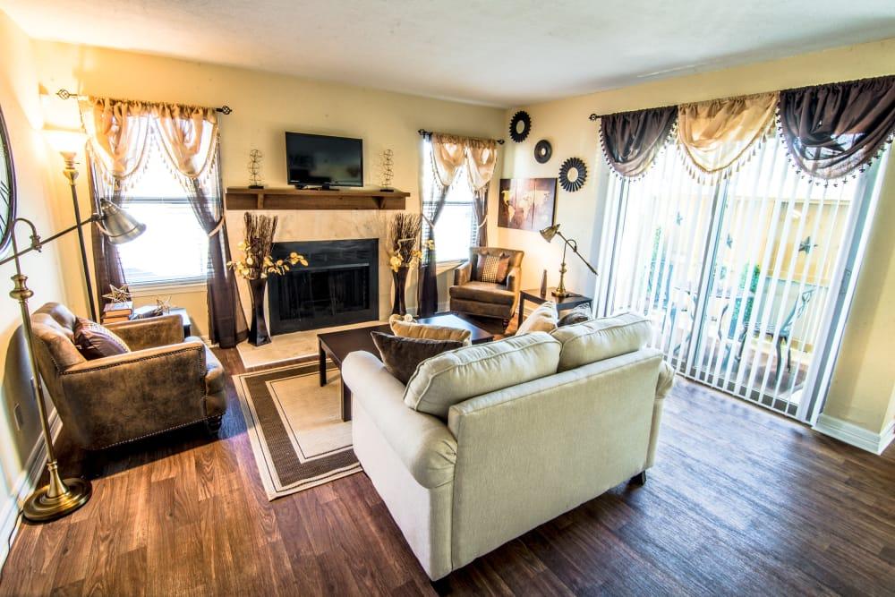 Sun-lit living room at Cedar Ridge Apartments