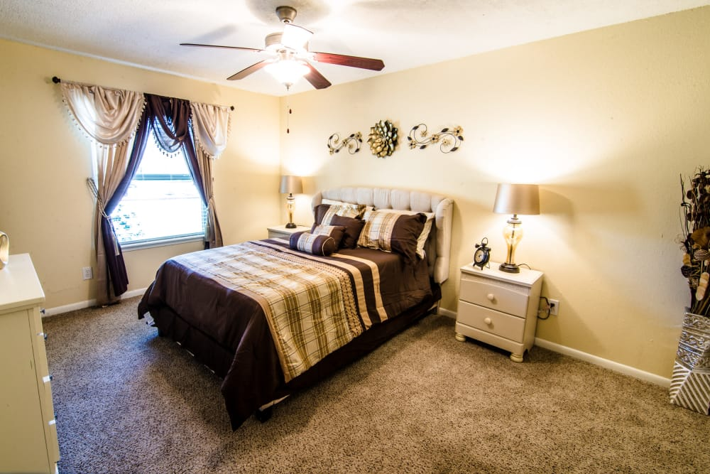 Sun-lit bedroom at Cedar Ridge Apartments