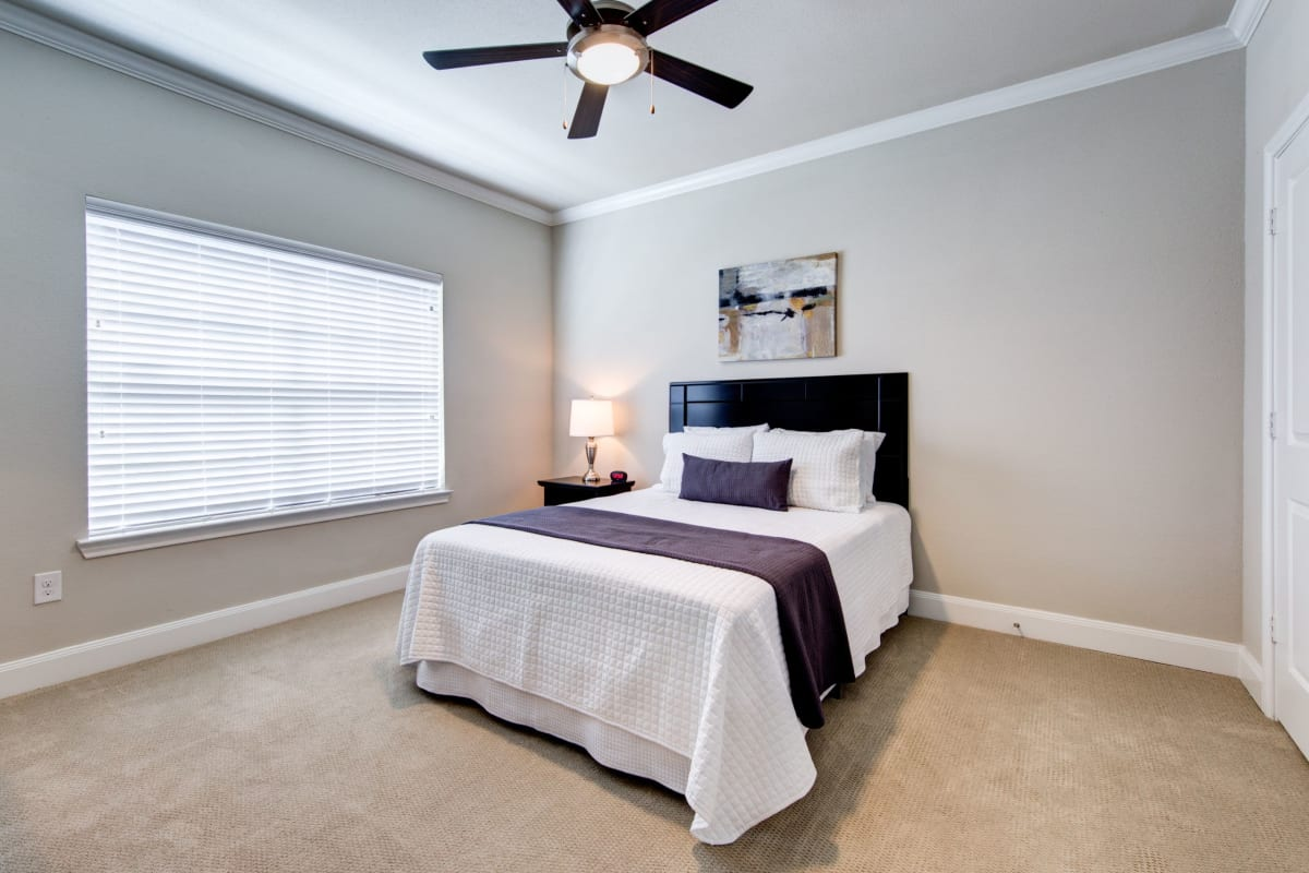 Bedroom with carpet flooring at Marquis on Memorial in Houston, Texas