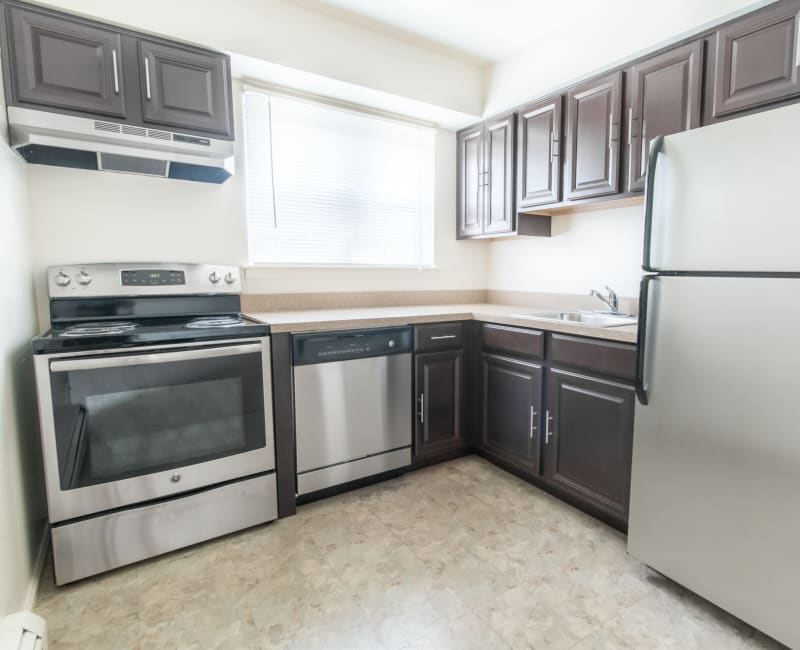 Fully equipped kitchen with stainless steel appliances in a model home at Brakeley Gardens in Phillipsburg, New Jersey