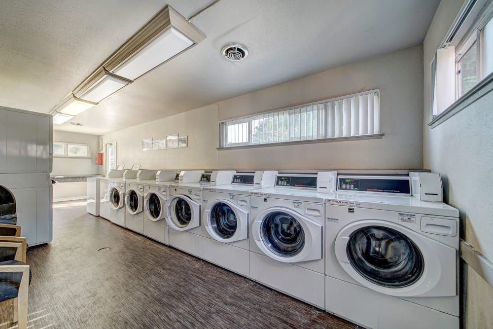 The convenient laundry room at The Timbers Apartments in Hayward, California
