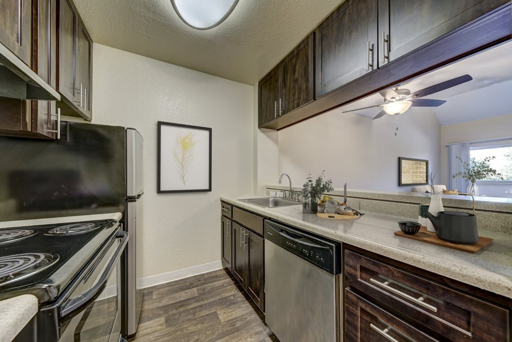 A kitchen with plenty of cabinet space at The Timbers Apartments in Hayward, California