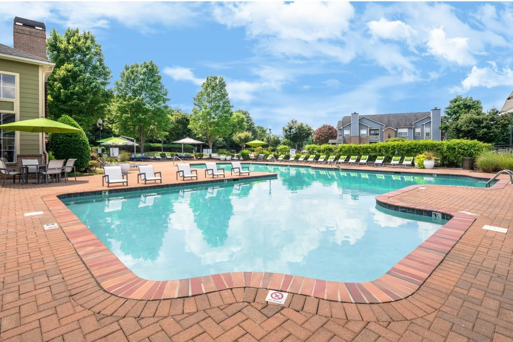 Resident pool with a brick surrounding floor at Highlands at Alexander Pointe in Charlotte, North Carolina
