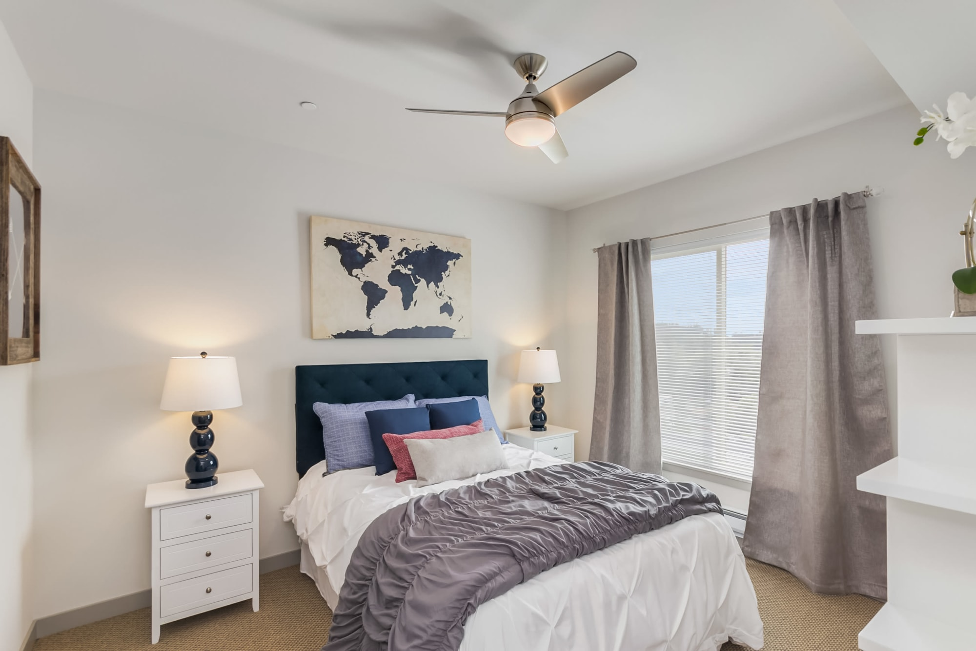 A master bedroom, with ceiling fan, at Tria Apartments in Newcastle, Washington