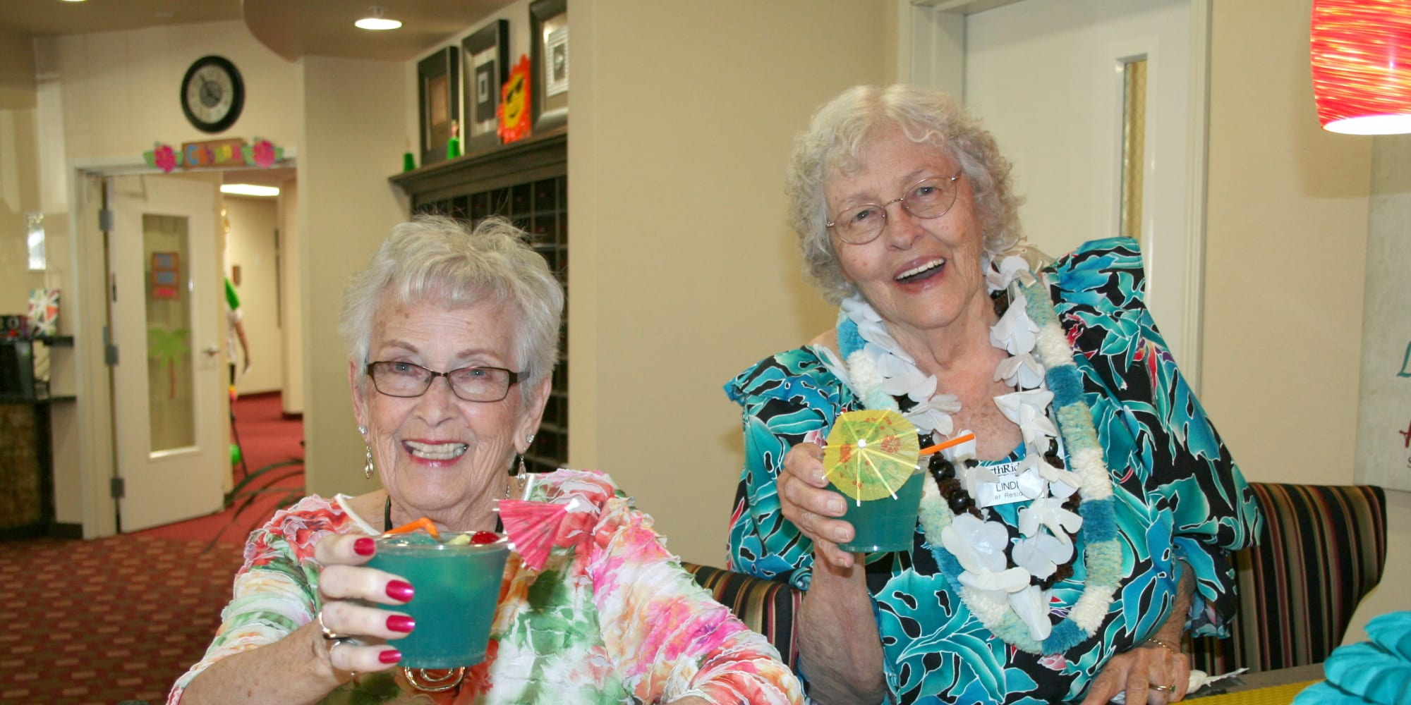 Two residents having drinks at Northridge Gracious Retirement Living in Fishers, Indiana