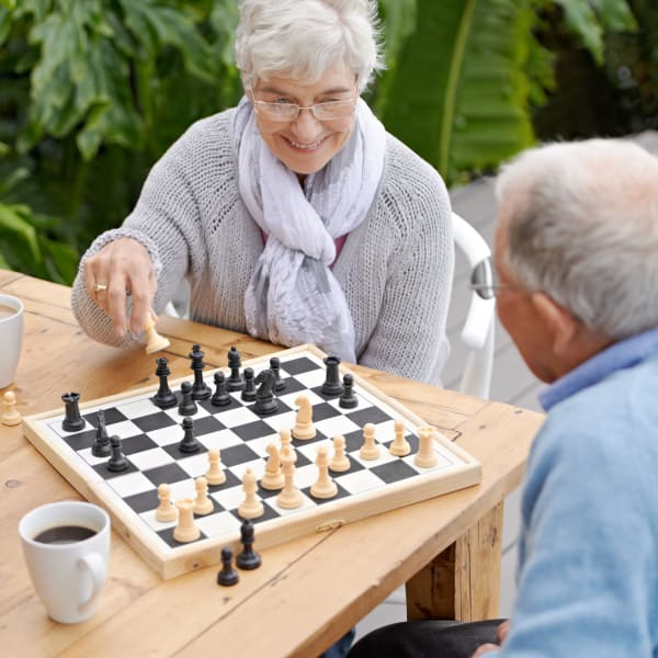 Residents playing chess at Pacifica Senior Living Menifee in Sun City, California.