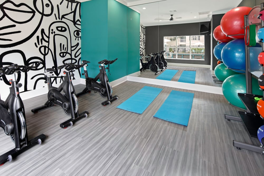 Yoga and spin room in the fitness center at Amira at Westly in Tampa, Florida