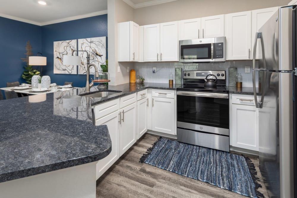 Modern open kitchen with hardwood floors at Mezza in Jacksonville, Florida