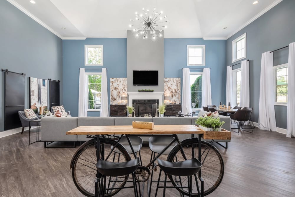 Well-furnished clubhouse lounge with a fireplace at Highlands at Alexander Pointe in Charlotte, North Carolina