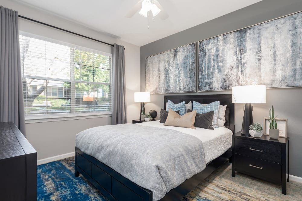 Primary bedroom with large bay windows in a model home at Highlands at Alexander Pointe in Charlotte, North Carolina
