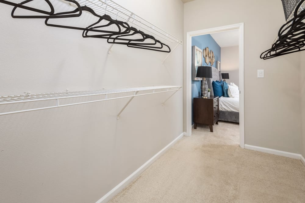 Walk-in closet in a model home's bedroom at Highlands at Alexander Pointe in Charlotte, North Carolina