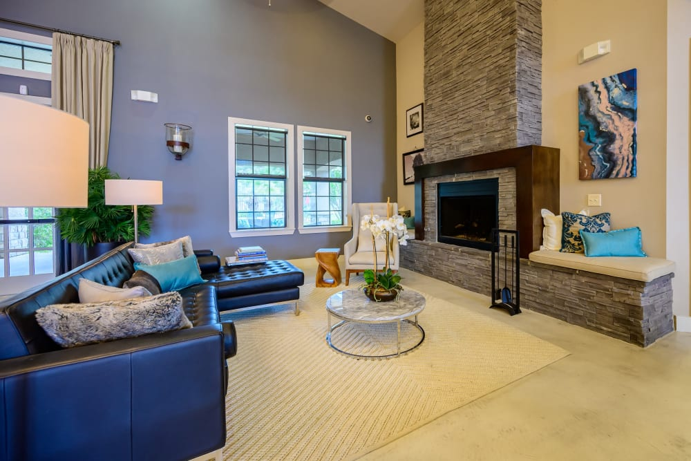 Clubhouse with amenities and fireplace poolside at Verandas at Shavano in San Antonio, Texas