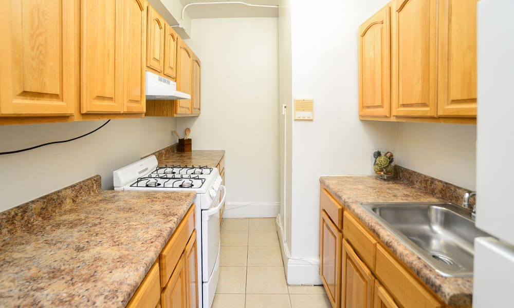 Galley Style Kitchen at St. Lukes Place Apartment Homes