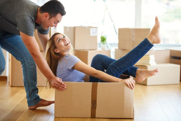 Couple moving boxes to store at Metro Self Storage in Mount Laurel, New Jersey