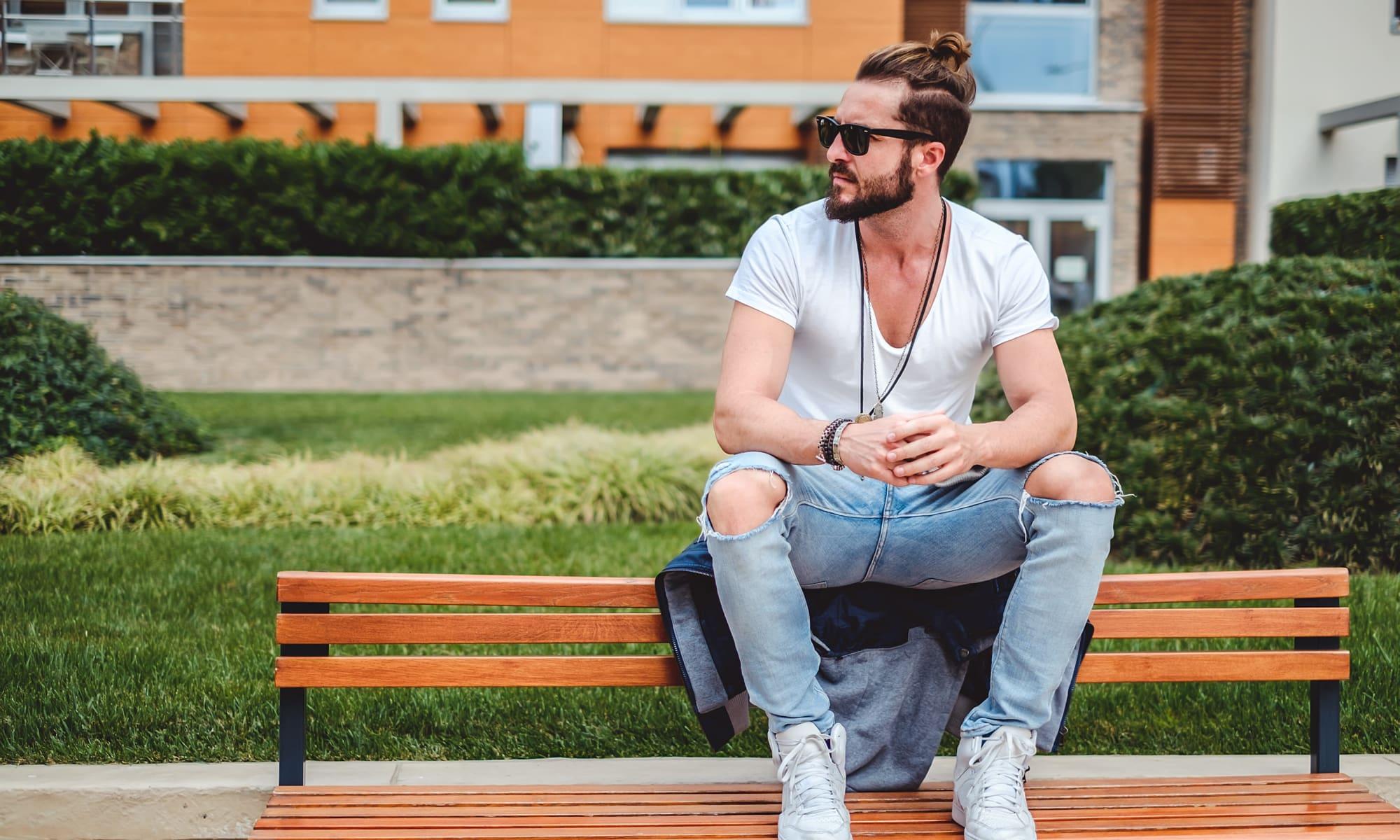 Man sitting on bench nearby Alta Citizen in Newport News