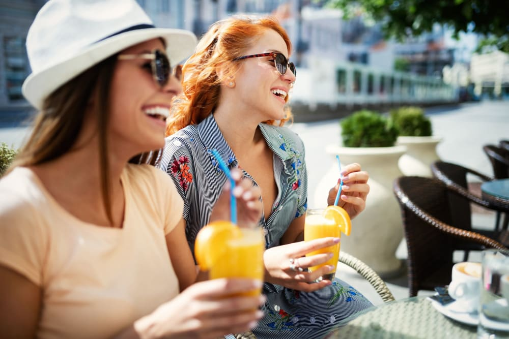 Residents enjoying lunch at the outdoor lounge at 770 C Street Apartments in Washington, District of Columbia