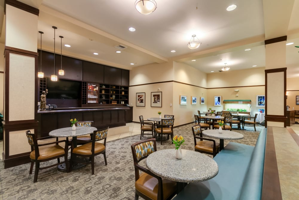 Dining room featuring a bistro at Merrill Gardens at Kirkland in Kirkland, Washington.