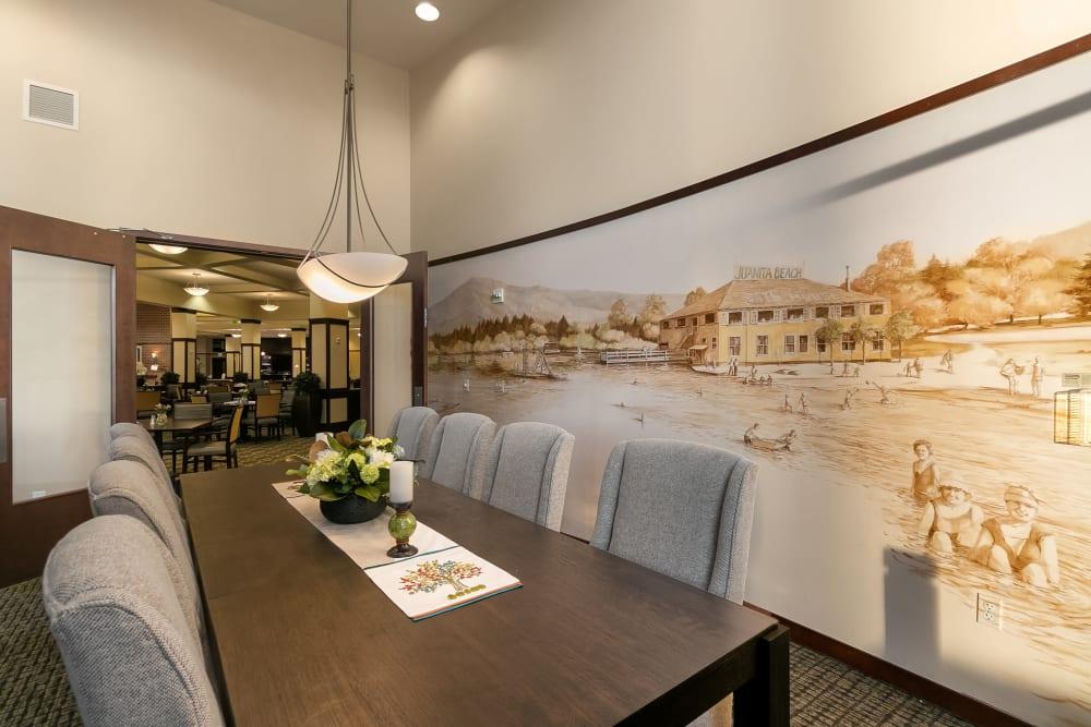 Private dining room featuring PNW artwork at Merrill Gardens at Kirkland in Kirkland, Washington.