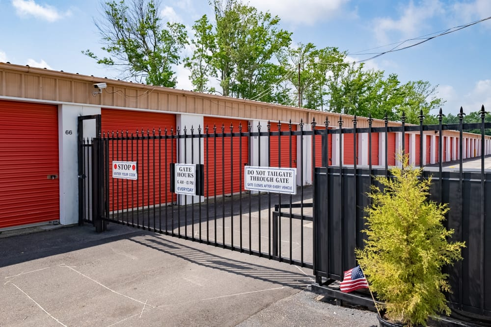 Storage units behind an iron gate at SecurityPlus Self Storage