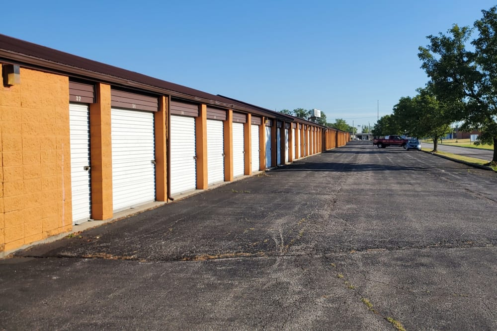 Wide driveway up to storage units with white doors at StayLock Storage in Fort Wayne, Indiana