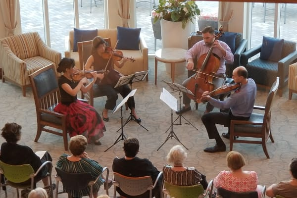 Residents enjoying the Lincoln String Quartet at All Seasons Naples in Naples, Florida