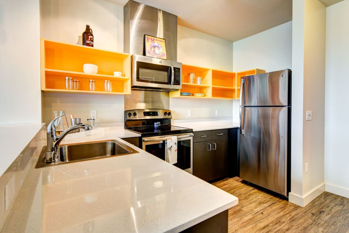 Modern kitchen with stainless steel appliances at Anthem on 12th in Seattle, Washington
