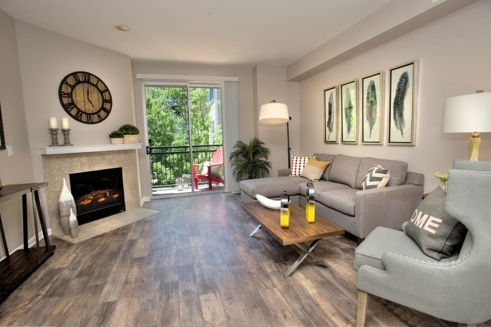 Model living room featuring distressed faux-hardwood flooring at Azure Apartment Homes in Petaluma, California