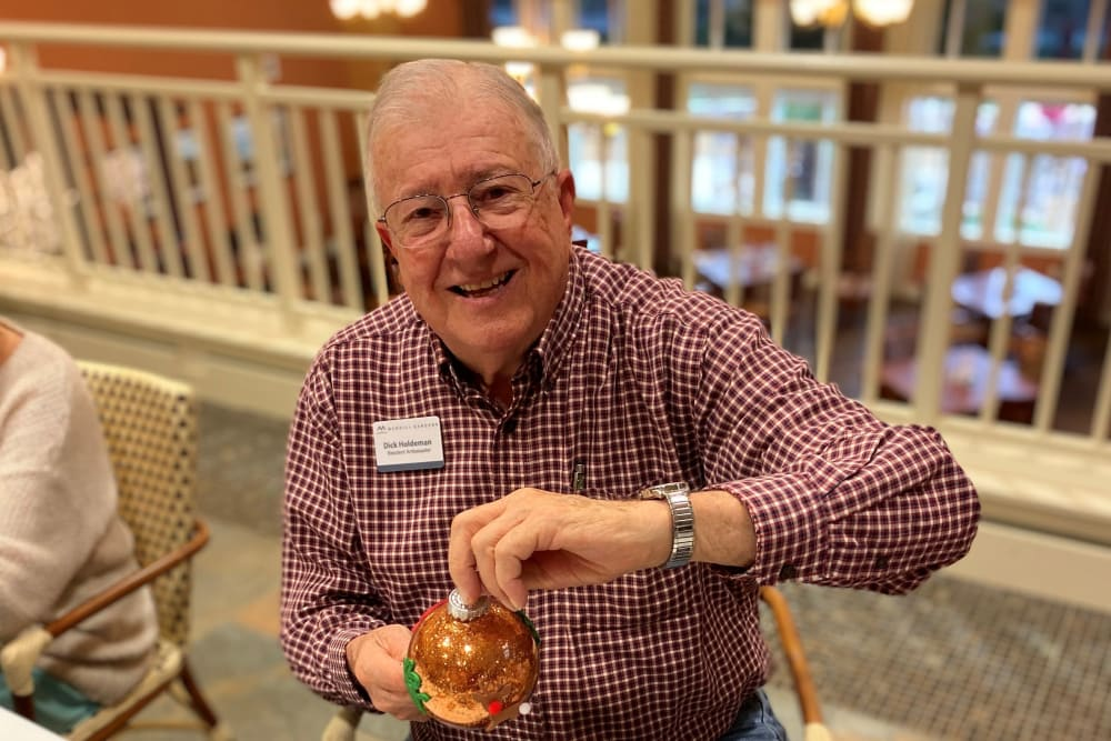 A resident making some holiday ornaments at The Pines, A Merrill Gardens Community in Rocklin, California.
