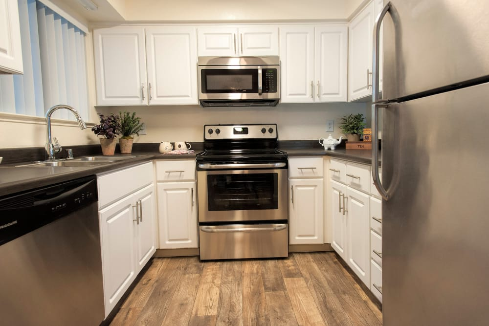 Model kitchen with stainless-steel appliances at Hidden Lake Condominium Rentals in Sacramento, California
