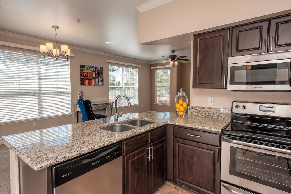 State-of-the-art kitchen with stainless-steel appliances at The Vintage at South Meadows Condominium Rentals in Reno, Nevada
