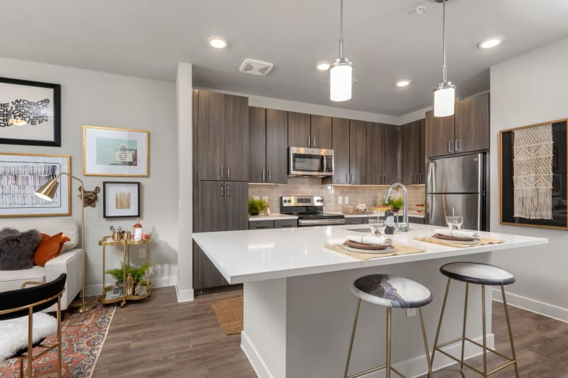 Open concept chefs kitchen with living room at Domain at Founders Parc in Euless, Texas
