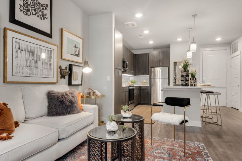 Spacious living room and kitchen area in a model home at Domain at Founders Parc in Euless, Texas