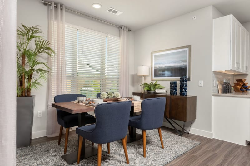 Modern dining area with wood table at Domain at Founders Parc in Euless, Texas