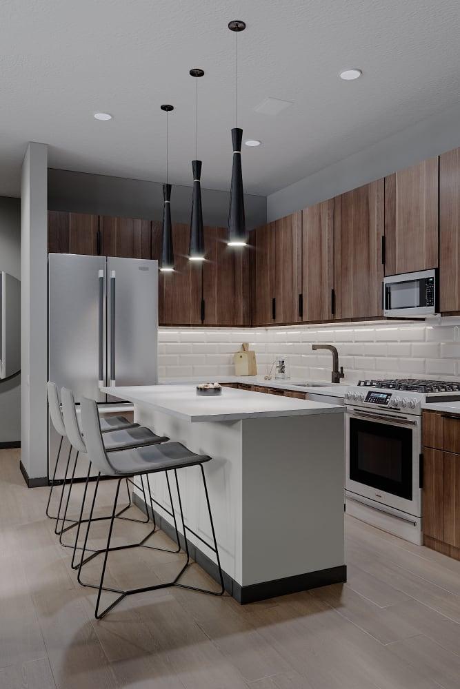 Sleek, modern kitchen space at Solana Stapleton Apartments in Denver, Colorado