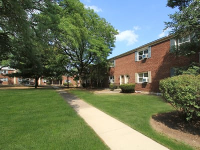 Spacious walking paths outside apartments at Elmwood Village Apartments & Townhomes in Elmwood Park, New Jersey