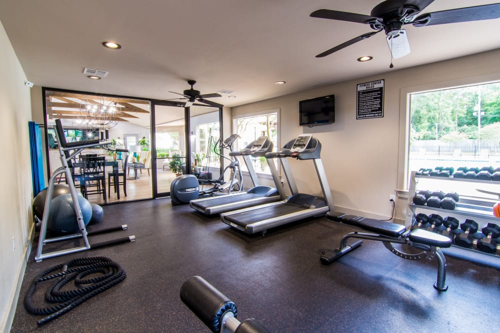 Fully-equipped fitness center at Deerbrook Forest Apartments