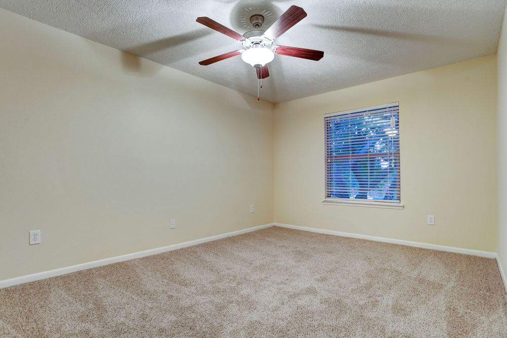 Vacant bedroom with fan at Cedar Ridge Apartments