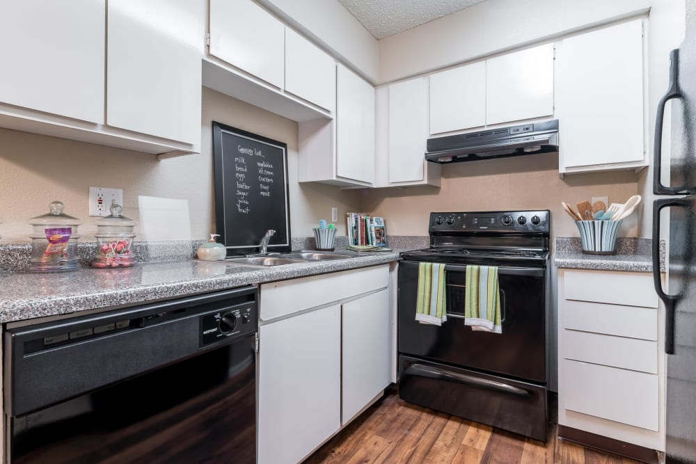 Modern kitchen appliances and ample storage in a kitchen at 8500 Harwood Apartment Homes in North Richland Hills, Texas