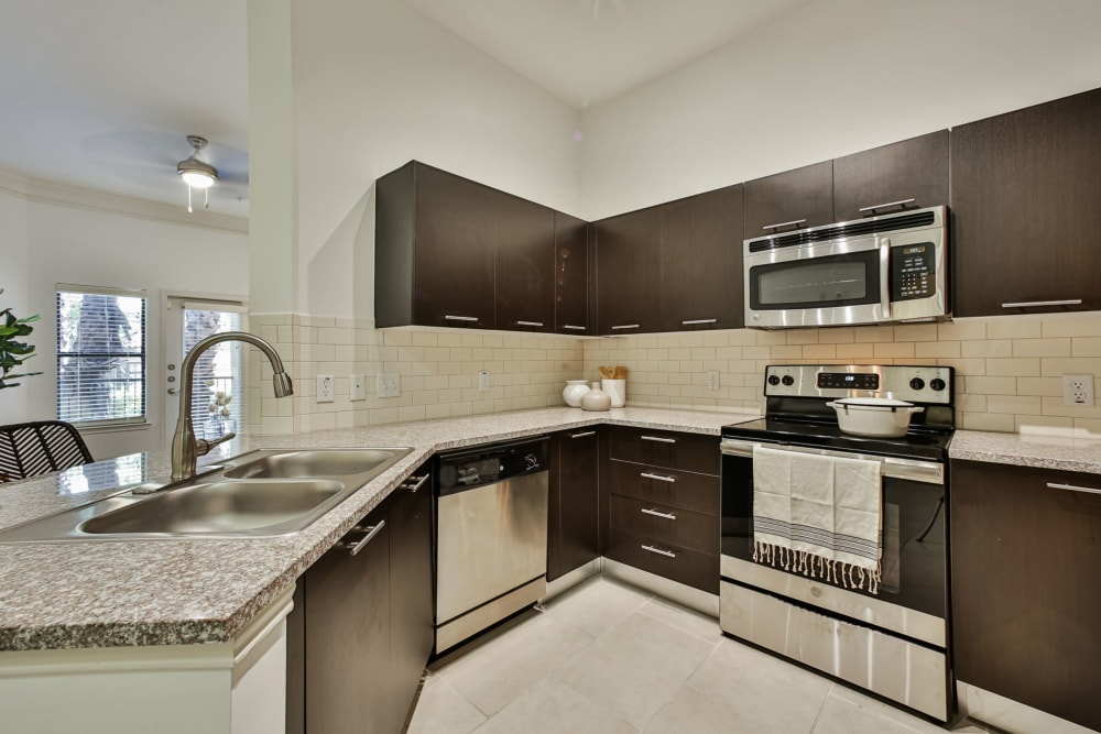 Granite countertops and vaulted ceilings at Broadstone Toscano in Houston, Texas