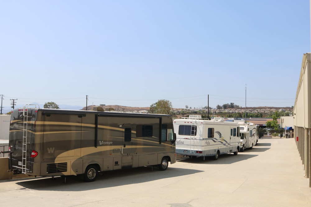 A row of RVs parked at Golden State Storage - Golden Triangle in Santa Clarita, California