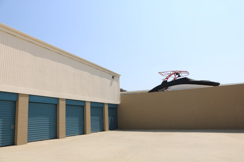 Drive-up storage and a boat at Golden State Storage - Golden Triangle in Santa Clarita, California