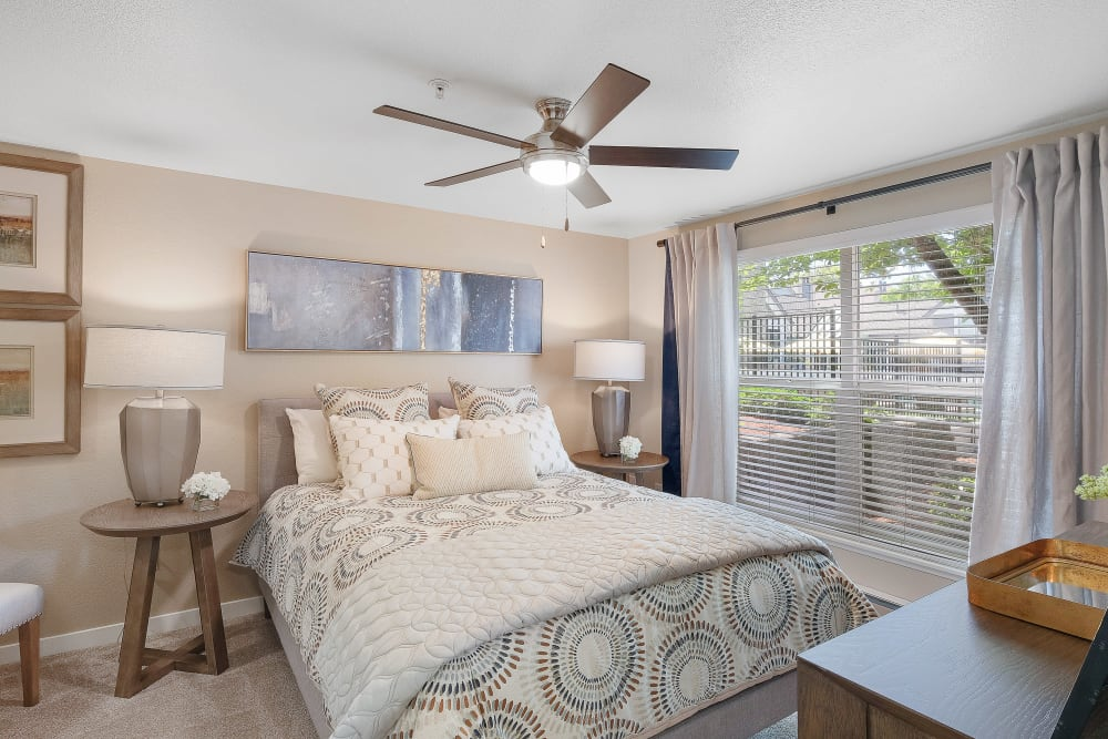 Enjoy a cozy bedroom at Centro Apartment Homes home in Hillsboro, Oregon
