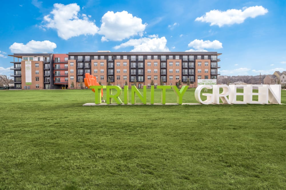 Apartment sign in grassy field at Alta Trinity Green