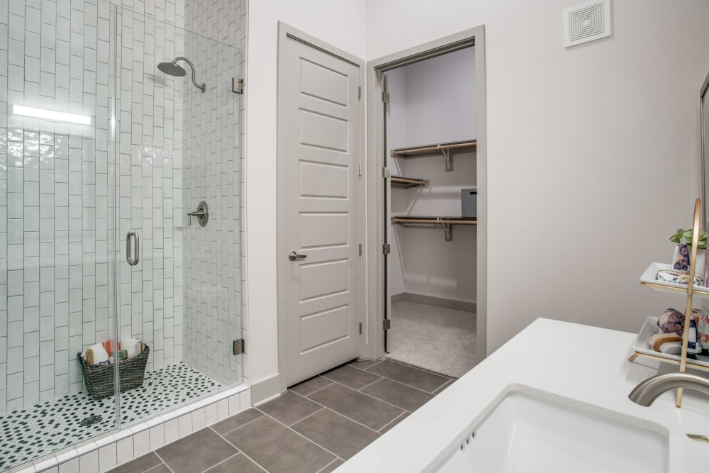 Clean, white bathroom at Alta Trinity Green in Dallas, Texas