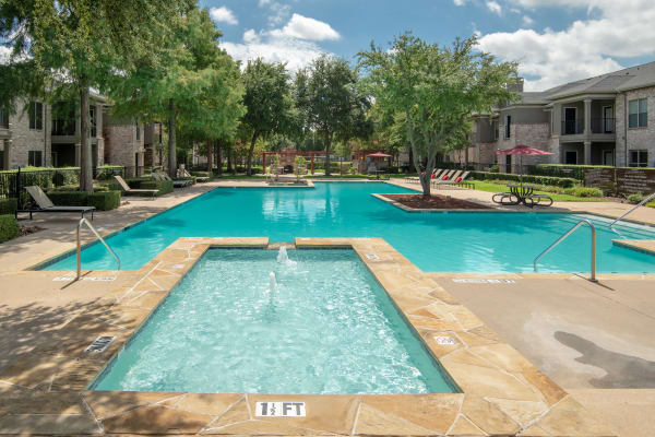 Beautiful swimming pool at The Springs of Indian Creek in Carrollton, Texas